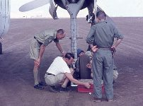Repair of Caribou aircraft wheel, courtesy of George Mayer.